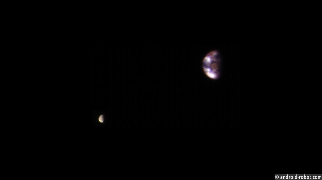 Размещено фото Земли иЛуны, выполненное сорбиты Марса