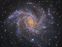 Темная материя замедляет вращение галактической полосы Млечного Пути